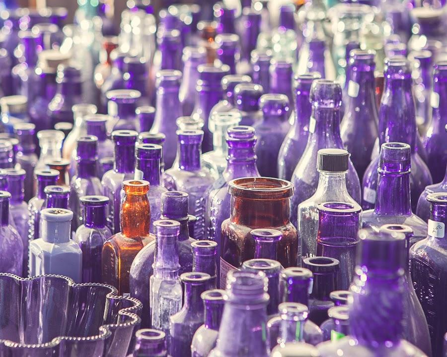 Sea of Light and Glass by Angel McNall - Artistic Objects Antiques ( antique glass, purple bottles, purple, still life, flea market, vintage glass, bottles, swap meet, bokeh, antiques,  )