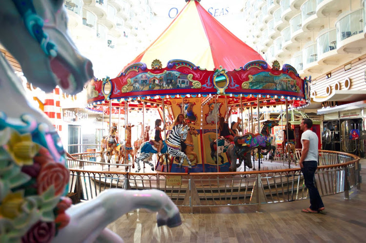 Walk along Oasis of the Seas' boardwalk for family entertainment — including a colorful carousel — dining options and more.