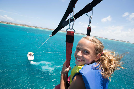 parasail-lift-Aruba - Get a bird's-eye view of Arub's beaches while parasailing.