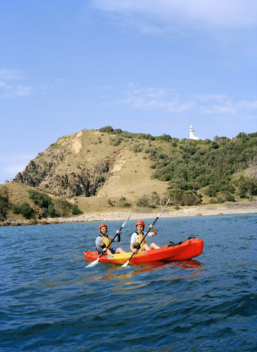 Kayaking_at_Byron_Bay - A couple kayaks around the front of the Cape Byron lighthouse in Byron Bay in the Northern Rivers/Tropical NSW region, Australia.