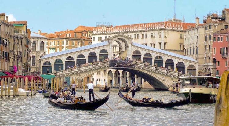 The Rialto Bridge, the oldest of the four bridges spanning the Grand Canal in Venice, Italy.