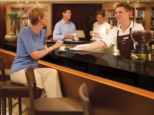 Roughing it? Enjoying a morning coffee drink at the coffee bar aboard Seabourn Quest.
