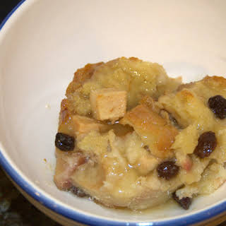 Rustic Vanilla Apple Bread Pudding with Caramel Whiskey Sauce.