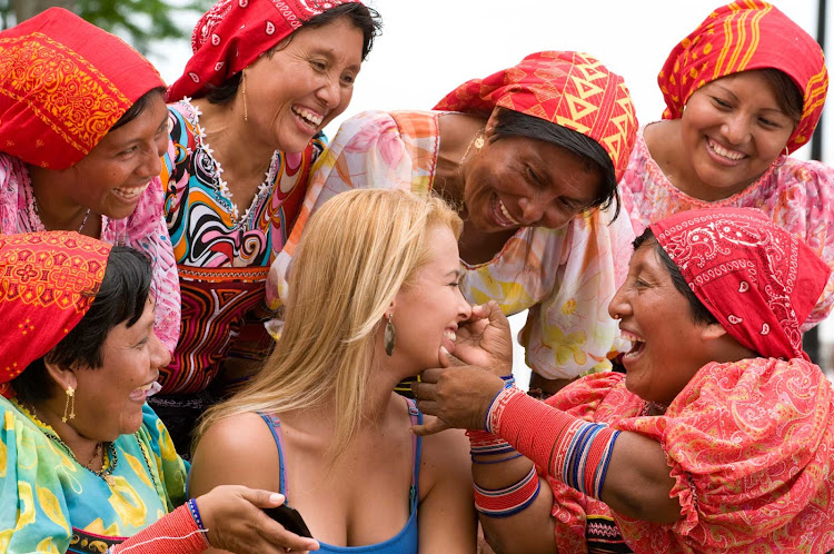 Local women joke with a visitor in Panama.