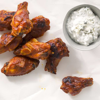 Bourbon-Glazed Chicken Drumettes with Blue Cheese Dipping Sauce.