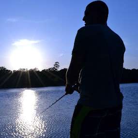 Silhouette on the lake by Cliff Dowden - People Portraits of Men ( sunset, silhouette, bass, fishing, boat,  )