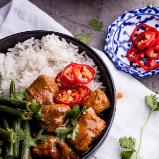 Spicy coconut chicken curry bowls with cardamom Basmati rice.