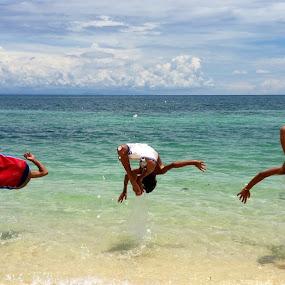 Side flip? by Dickson   Shia - Babies & Children Children Candids ( kids playing in summer, side flip, lifestyle, sea, summer, kids, beach, travel, people, culture, KidsOfSummer,  )
