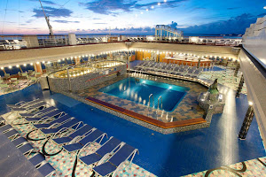 The Versailles Pool on Carnival Liberty features two spas, one great pool and a whole lot of deck chairs.