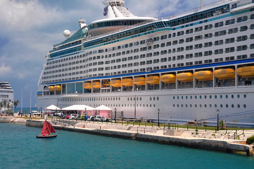 dinghy-Explorer-of-Seas-Bermuda - Opposites attract: a tiny dinghy next to the mega cruise ship Explorer of the Seas.