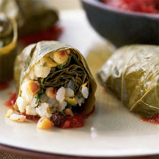 Brown Rice-Stuffed Grape Leaves in Tomato Sauce.