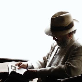 Man reading at a café. by Christos Demopoulos - People Portraits of Men ( argentina, café, buenos aires, portrait, man )