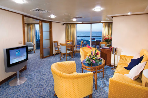 The Owner's Suites aboard Norwegian Sky feature private balconies and separate living and dining areas.