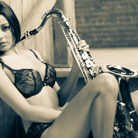 Girl with a Saxophone by Vikram Mehta - Black & White Portraits & People ( music, girl, black and white, saxophone,  )