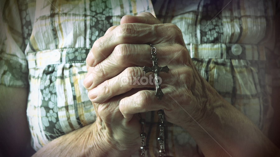 Senior hands holding rosary or crucifix while praying by Toronto-Images .Com - People Body Parts ( blessed, person, old, purity, people, aged, religion, love, spiritual, woman, pray, belief, church, symbol, ritual, worship, sign, rosary, jesus, fingers, christ, meditation, bible, culture, senior, hope, cross, prayer, concept, christian, god, gospel, christianity, holy, object, believe, hand, crucifix, spirituality, believer, closeup, despair, peaceful, faith, traditional, beads, catholicism, catholic, bead, female )