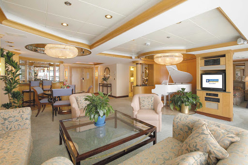 Legend-of-the-Seas-Royal-Suite - Luxury comforts on Legend of the Seas' Royal Suite include a separate bedroom and king bed, private balcony, separate living room and queen-size sofa.