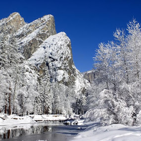 Yosemite National Park, California by Ken Miller - Landscapes Mountains & Hills ( mountains, national park, winter, yosemite, california, snow, trees, merced river, three brothers, landscape, river, , cold )