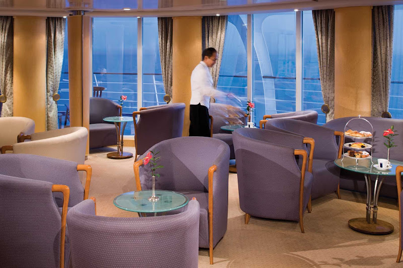 Get a complimentary drink, listen to elegant music and mingle with friends in the Panorama Lounge onboard Silver Whisper.