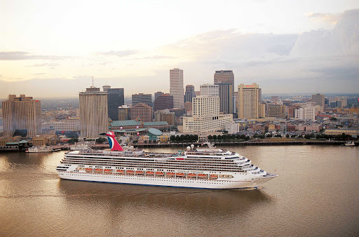 Carnival-Conquest-New-Orleans - Carnival Conquest cruises past the New Orleans skyline.