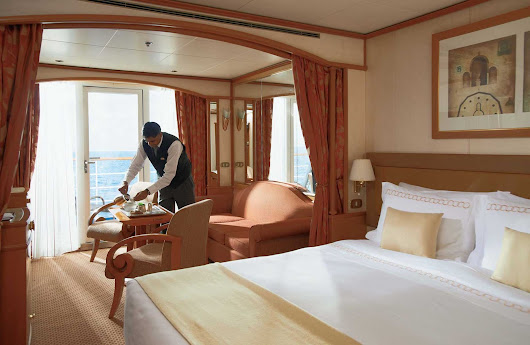 Silver Cloud's Veranda Suite features a private teak veranda where you can enjoy a beautiful sunset. As with all suites, butler service is standard.