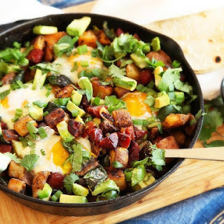 Crispy Potato, Chorizo, and Green Chili Hash With Avocado and Eggs