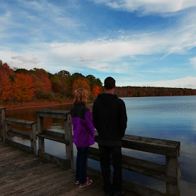 Siblings At The Autumn Lake by Annette Long-Soller - People Family ( sky, autumn, looking out at water, beautiful afternoon, lake, landscape, siblings )