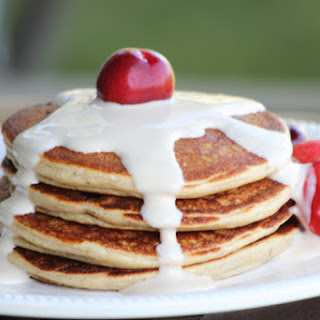 Bitter-Sweet Cherry Almond Protein Pancakes w/ maple yogurt topping.