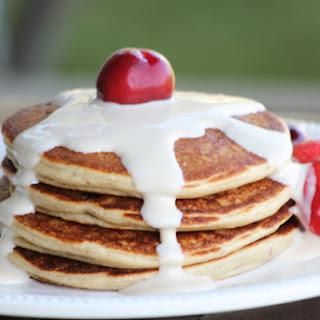 Bitter-Sweet Cherry Almond Protein Pancakes w/ maple yogurt topping..