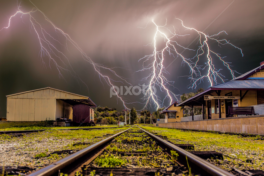 Sparks at the tracks by Craig Eccles - Landscapes Weather ( thunder, clouds, train station, lightning, lightning bolt., weather, cloud, train, thunder storm, storm )
