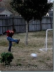Caleb kicking the ball