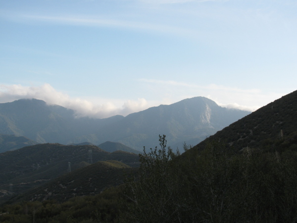 Clouds coming in low over the mountains.