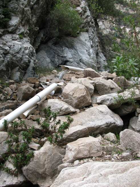 A 4 inch pipe spewing water back into the canyon it should be in anyway.