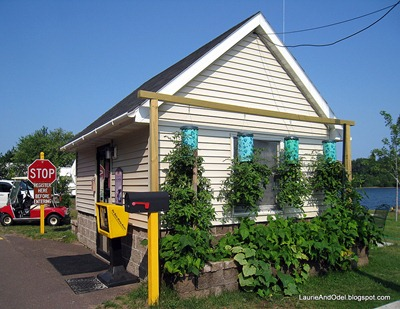 Houghton RV Park Office with vegetable garden.
