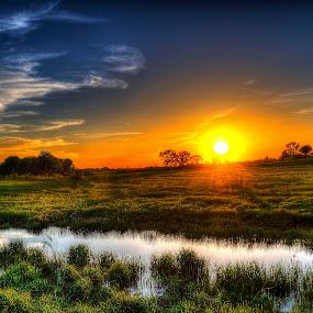 Edge of Night by John Larson - Landscapes Sunsets & Sunrises ( clouds, sunburst, stream, sky, grass, sunset, trees, fields )