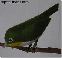 white eye felted bird
