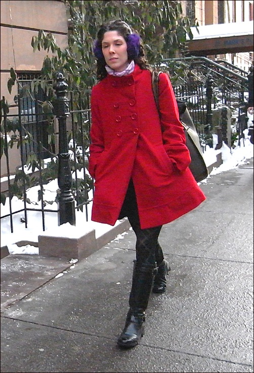 w red coat blk boots earmuffs