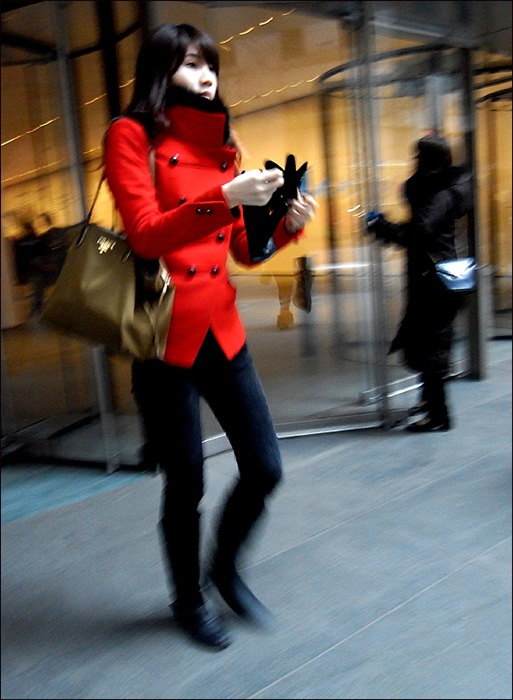 w red coat leaving moma 3 0l