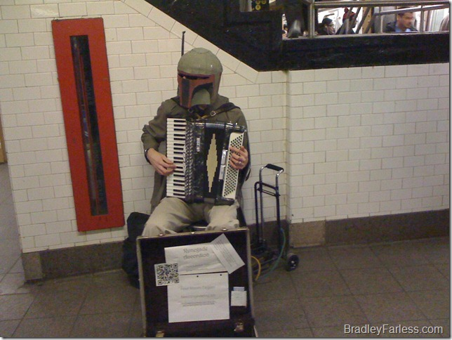 Boba Fett playing accordion on the L Train platform at Union Square.