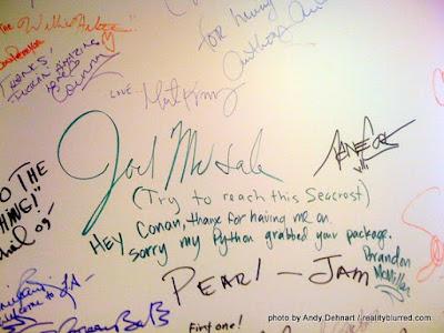 Joel McHale's signature on Conan's wall