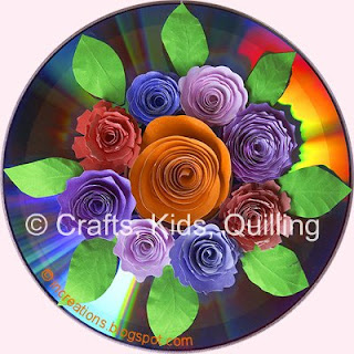 Paper flowers on a CD