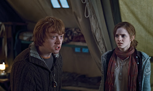 Rupert Grint as Ron Weasley and Emma Watson as Hermione Granger (Deathly Hallows)