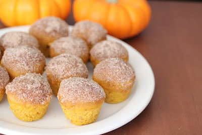 photo of a plate of Cinnamon Sugar Pumpkin Donut Muffins