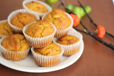 muffins stacked on a white plate.