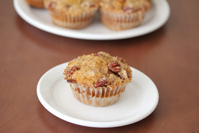 photo of one Pecan streusel pumpkin muffin on a plate