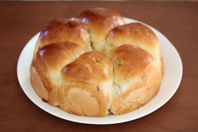 raisin rolls on a white plate