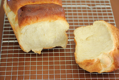 photo of a loaf of milk bread with a piece torn off