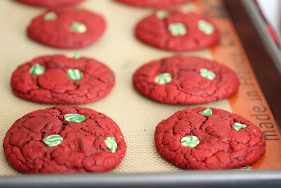 photo of Red Velvet Chocolate Chip Cookies on a baking sheet