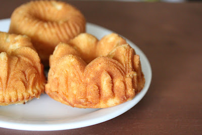 close-up photo of a plate of mini rum cakes
