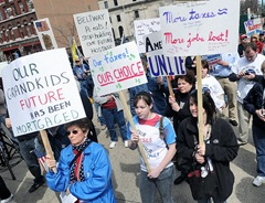 Shirley Pavetto of Lysander, left, held her sign with Sarah St. Amand and Lauren Marsh of Baldwinsville during the Tax Day Tea Party protest held outside of the James M. Hanley Federal Building in Syracuse.  John Berry / The Post-Standard