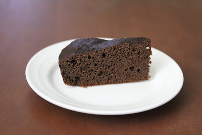 photo of a slice of steamed chocolate cake